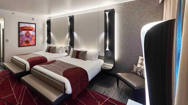 n032035_2024oct23_world_disney-new-york-art-of-marvel-hotel_superior-room-concept-art_16-9_tcm808-195140$w~1280$p~1